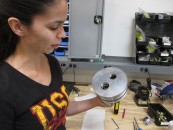 Cassandra Mercury shows off Hyperloop Levitational Rig camera, by Alison van Diggelen