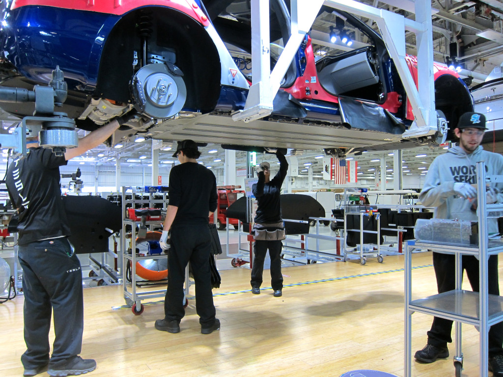 Men & Women on Tesla production line, photo by FreshDialogues